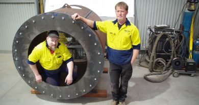 Paul O'Keefe and Andrew Rye from Amped Up with the smokebox for a new steam train being built to run on the Victorian Goldfields Railway line.