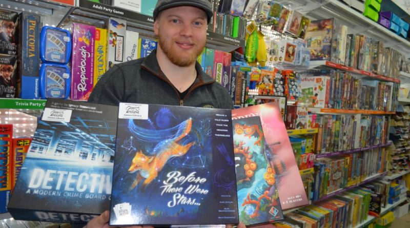 Justin Hallam-Stephens is pictured with some of his new games.