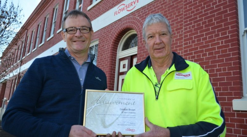 Flowserve general manager David Boak presents long serving employee Gordon Brown with a certificate marking the 50 year milestone.