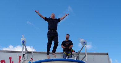 Senior sergeant Pete Carey of Castlemaine Police jumping into the tank of ice cold water to raise funds to help find a cure for MND.