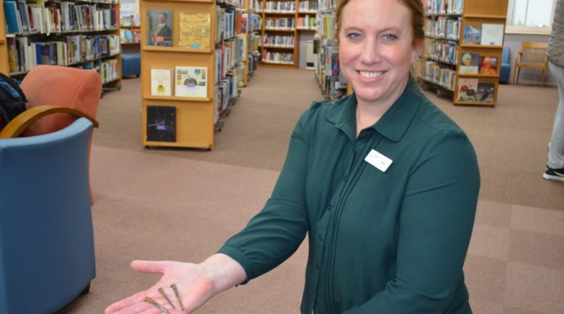 Library manager Jess Saunders with some of the original handmade floor nails.