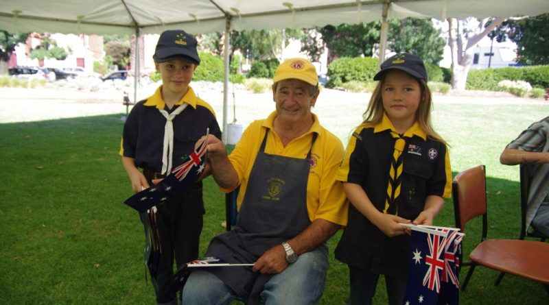 Shem and Leah with Ken McKimmie from the Lions Club of Castlemaine at the Australia Day celebration in Castlemaine last year. Photo: Max Lesser.
