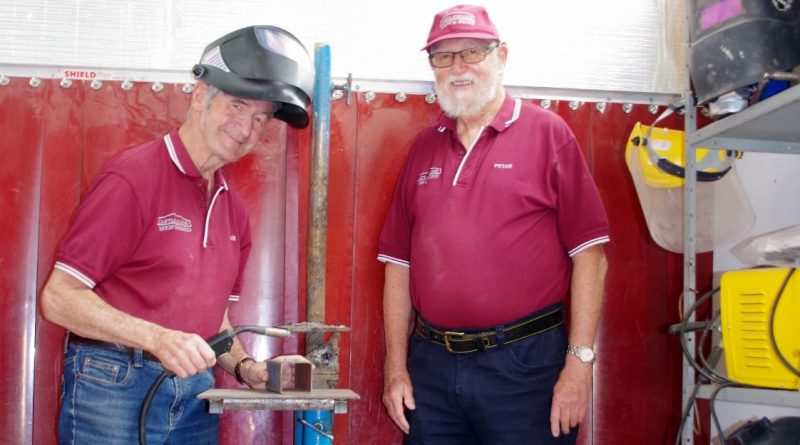 Castlemaine Men's Shed president Brian McCormick and treasurer Peter Batten in the shed's almost complete welding bay